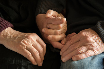 Old couple's hands - holding