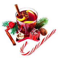 Christmas Hot mulled wine for winter with spices isolated on white background, traditional drink on winter holidays, closeup.