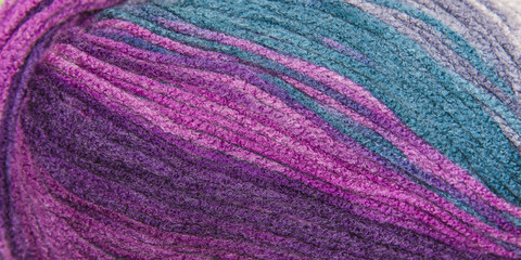 background thread for knitting. Knitting pattern of colorful yarn wool.