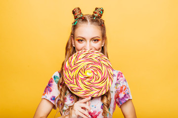 Woman with huge candy instead of a head