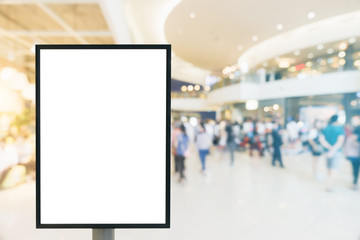 Blank mock up of vertical poster billboard sign with copy space for your text message or content in modern shopping mall. Blank mock up of vertical street poster billboard department store background.