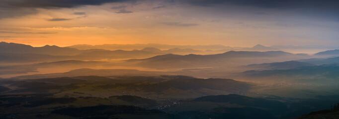 Panoramic view of sunrise in Tatra mountain.