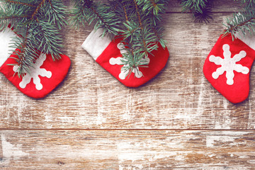 Christmas decorations on old boards. Christmas background. Christmas Socks. New Year background. Xmax background. Christmas tree. Toned image.