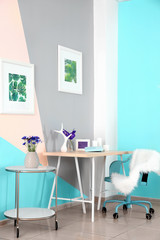 Lilac accent in modern interior. Comfortable workplace at home