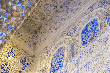 Seville, Spain - October 11, 2017: Closeup of the detailed carvings on the walls, ceilings and arches of the Royal Alcazar