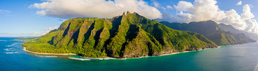 Amazing aerial view of the Na Pali coast cliffs from above. Beautiful Pacific ocean, sunlight and...
