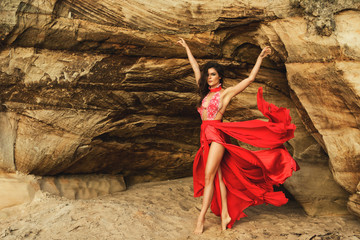 Beautiful and sensual woman wearing luxury red dress