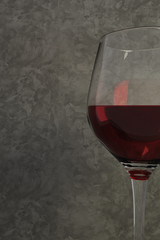 3D rendering of a half of red wine glass o