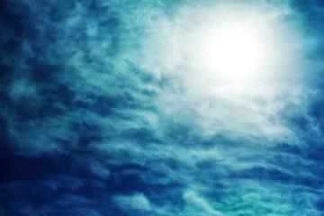dark sky with sun and cloud