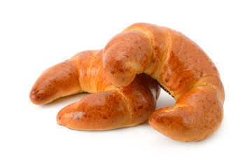 Two fresh croissants isolated on white background.