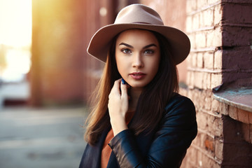 Close-up Fashion woman portrait of young pretty trendy girl posing at the city, street fashion
