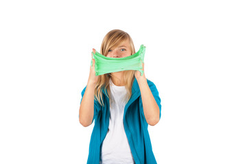 Funny girl holding green slime looks like gunk in front of her face. Isolated on white background.