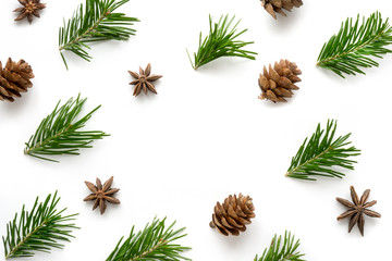 Christmas background. Pine branches, cones and star anise. Copy space in center.