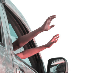 Children  hands out of the car window