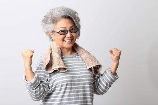 The senior Asian woman on the white background.