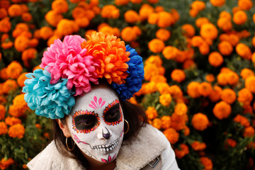 "Woman dressed up as ""Catrina"", a Mexican character also known as ""The Elegant Death"", takes part in a Catrinas parade in Mexico City"