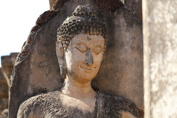 closeup 400 years old of ancient stone buddha statue in the forest, art crafting sculpture, head, face, lobe, ear, hair, nose, backgrounds, wallpaper