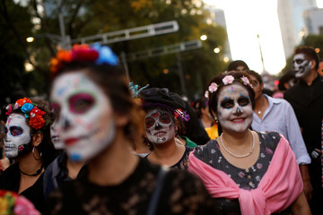 "Women dressed up as ""Catrina"", a Mexican character also known as ""The Elegant Death"", take part in a Catrinas parade in Mexico City, Mexico"