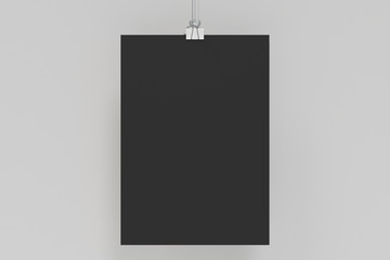 Blank black poster with binder clip mockup on white background