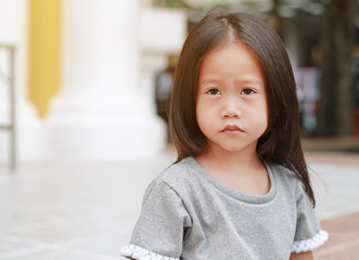 Cute asian child girl outdoor. Portrait beautiful girl looking something.