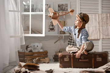 Boy in his room playing with plane