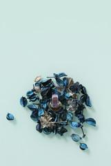 Artificial rose petals around perfume bottle - Mockup