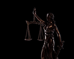 side view picture of goddess of justice statue