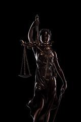 goddess iustitia statue on black background