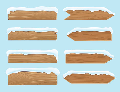 Wood banners planks covered with snow. Festive christmas vector decoration isolated