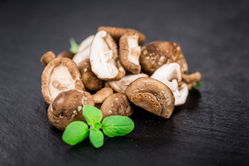 Portion of Raw Shiitake mushrooms on a slate slab