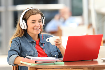 Relaxed student watching media on line in a coffee shop