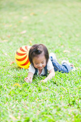 Cute Girl 2-3 Year Old Playing Ball in the garden
