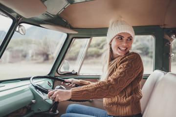 Woman on roadtrip driving a van