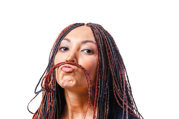 5e284424f33ef Isolated studio shot of a Funny Young Woman making mustache with her dread  locks hair