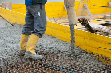 pouring concrete on steel iron fence