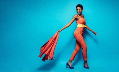 Fashionable african woman in stylish outfit Wall mural