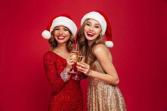 Two happy smiling girls in christmas hats