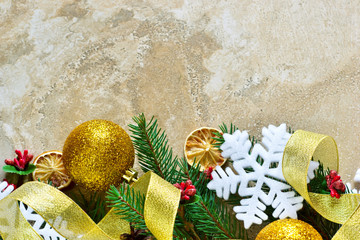 Happy New Year and Merry Christmas. New-year concrete background with spruce and decorations from balls and snowflakes.