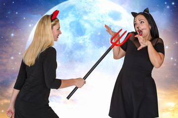 Halloween.Two young woman in Halloween costumes scaring Trident .