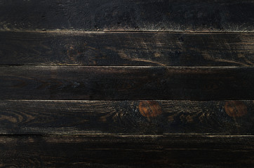 Black painted wood texture background, copy space, top view