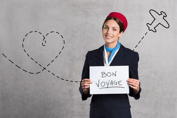 Flight assistant wishing Bon Voyage