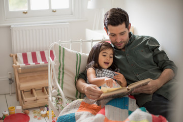 Father reading Daughter a bedtime story