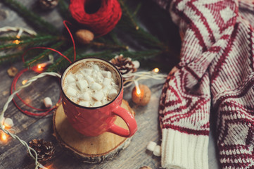 Wall Murals Christmas christmas table top view with hot cocoa, warm knitted sweater and garland. Cozy winter morning at home