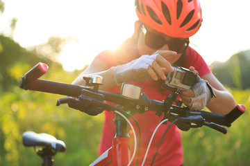 cyclist mount the action camera on mountain bike