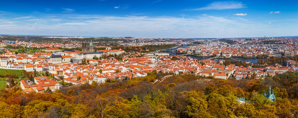 Autumn panoramic aerial view of houses and roofs of Prague old city town including Prague Castle and Charles bridge. Czech Republic