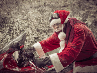 Santa Claus funny joker on the red fast motorcycle