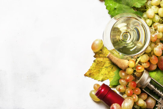 Dry white wine from sauvignon grapes, top view, selective focus