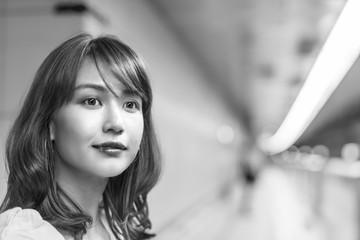 Beautiful asian woman inside subway station