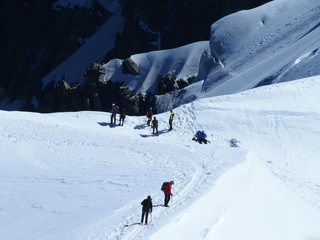 Several alpinists, mountain climber at AIGUILLE DU MIDI, CHAMONIX MONT BLANC in french ALPS