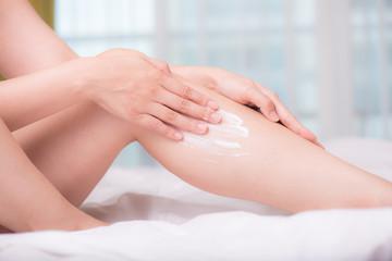 close up of women hands receiving sunblock cream lotion